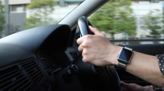 Japanese man driving with smartwatch on his wrist Stock Footage