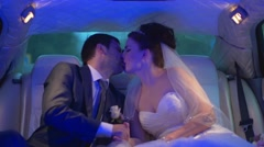 wedding, the bride and groom kissing in limo - stock footage