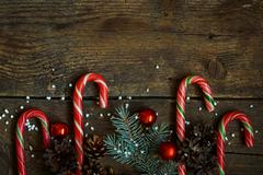 Christmas border with pine tree branches, cones, christmas decorations and ca - stock photo