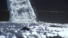 River descends between rocks with background waterfall splashing spectacular Stock Footage