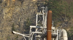 Close panning down old lonley cement factory in front of quarry Stock Footage