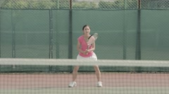 Young Japanese female tennis player in action on the court Stock Footage