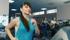 Attractive woman trained in the gym, running on a treadmill - stock footage