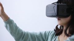 Japanese young woman using virtual reality device Stock Footage