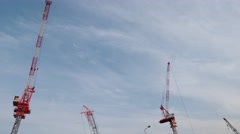 Time lapse footage of construction cranes and sky Stock Footage