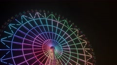 Time lapse of ferris wheel rotating at night Stock Footage
