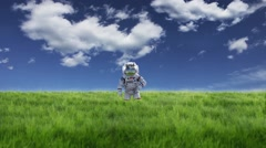 CG animation of astronaut standing on grassland - stock footage