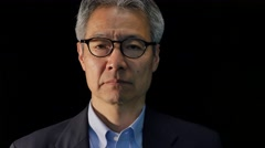 Portrait of senior Japanese man in a suit - stock footage