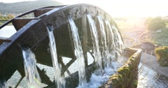 A water wheel to lift water for irrigation of grape fields Stock Footage