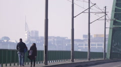 Stock Video Footage of Traffic over Belgrade bridges. Misty morning, urban scene. Belgrade city, Serbia