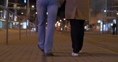 Couple walking in the evening city Stock Footage