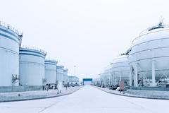Oil and fuel tanks in oil depot Stock Photos
