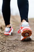 Walking or running legs in forest, adventure and exercising Stock Photos