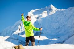 Man hiking in Himalaya Mountains in Nepal Stock Photos