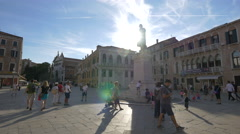Tourists relaxing at the Statue of Nicolò Tommaseo in Venice Stock Footage