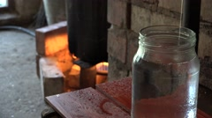 Last stage of illegal hooch alcohol drink process in rural farm room. 4K Stock Footage