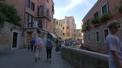 Walking and running along a small canal in Venice Stock Footage