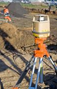 Theodolite on construction site - stock photo