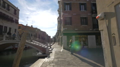 People coming down the stairs on a bridge in Venice Stock Footage