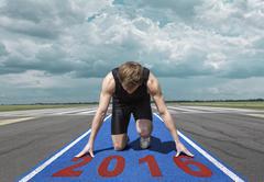 Runner start position runway - stock photo