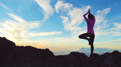 Young Woman Standing Yoga Pose on top of Mountain. Reaching the Top. Stock Footage