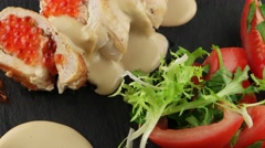 Stuffed chicken fillet with red caviar - stock footage