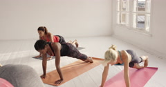 Stock Video Footage of Yoga class multi racial group of women exercising fitness healthy lifestyle