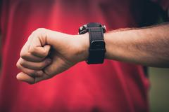 Runner training and using heart rate monitor smart watch Stock Photos