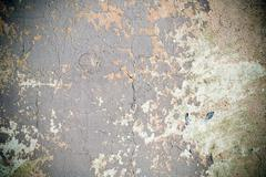Grunge wall with peeling paint, texture with vignette - stock photo