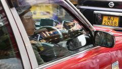 Close up view on taxi driver with multiple navigation system at dashboard Stock Footage