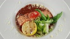Salmon in red tomato sauce with caviar Stock Footage