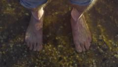 Birds Eye View Of Crystal Clear Water, Man Steps Into Frame, Closeup Of His Feet Stock Footage