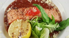 Salmon in red tomato sauce with caviar - stock footage