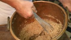 German baker mixing grain for traditional bread close Stock Footage