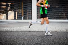 People running in city marathon Stock Photos