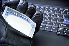 Identity theft on laptop computer - stock photo