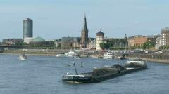 4K UHD Düsseldorf Dusseldorf Duesseldorf coal barge on Rhine river canal Stock Footage