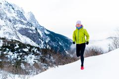 Stock Photo of Woman running in winter, fitness inspiration and motivation