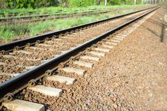 Railroad tracks and green grass Stock Photos