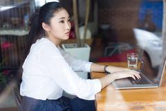 beautiful hipster woman using laptop at cafe - stock photo