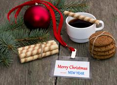 fir-tree branch, coffee, oatmeal cookies and label Christmas - stock photo