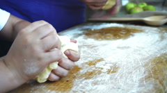 Mother and son kneading dough Stock Footage