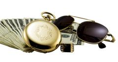 Antique gold watch, gold sun glasses and stack of money dollars set isolated - stock photo