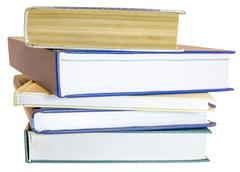 Pile of books and workbooks isolated on white Stock Photos