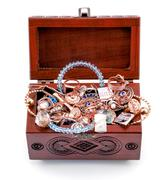 Opened redwood carved casket handmade with jewelry isolated on white - stock photo