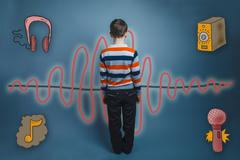 Teenager boy turned the sound wave music radio sketch symbol Stock Photos