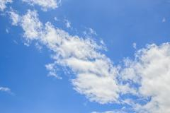 White clouds in the blue sky - stock photo