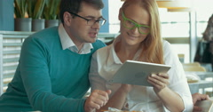 Young people with pad choosing something in Internet Stock Footage