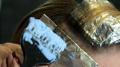 Applying lightener to the hair Stock Footage