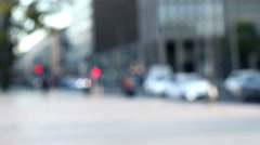 traffic lights and bokeh in out of focus urban context with some people walking - stock footage